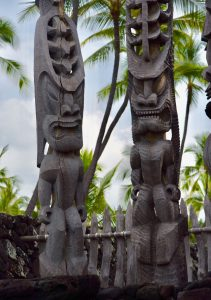 Statues that look like Beavis and Butthead at Pu'uhonua o Honaunau National Historical Park