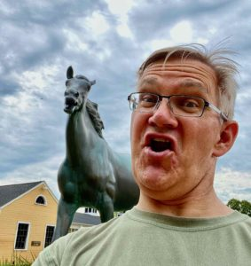 A selfie with a horse statue.